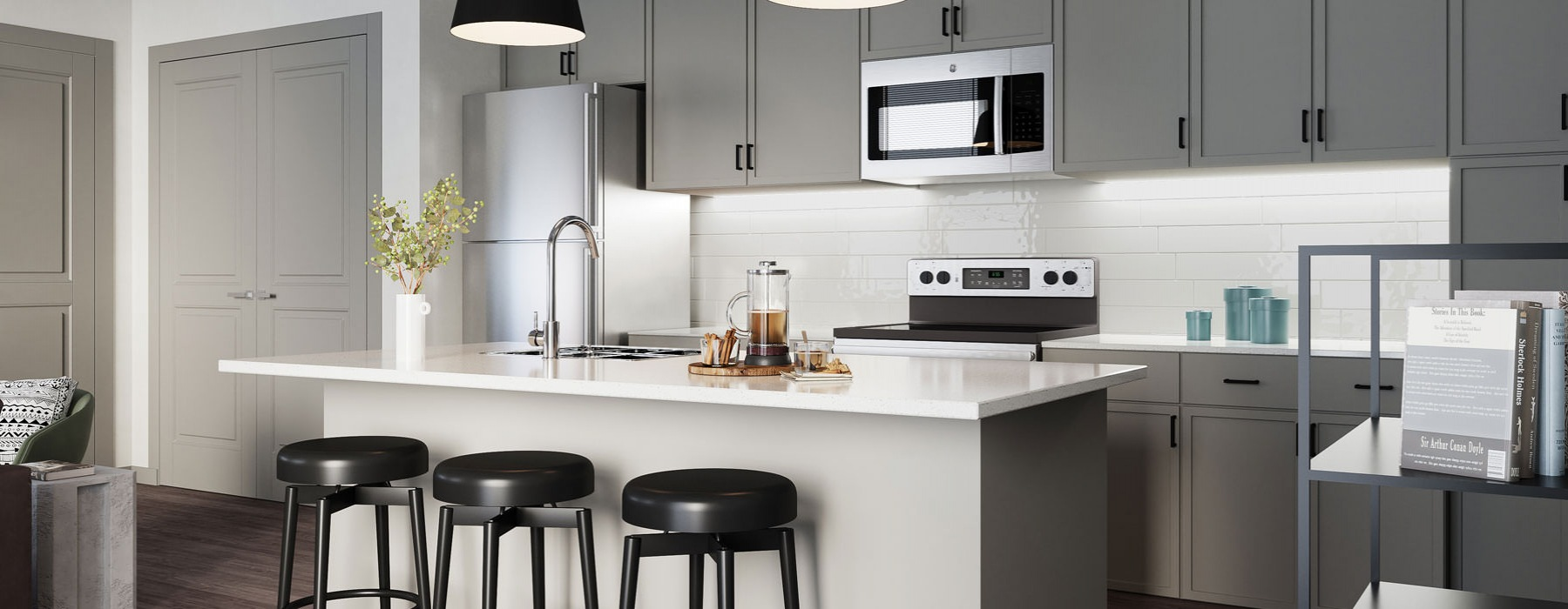 Kitchen features modern grey cabinets, black pending lights and white countertops